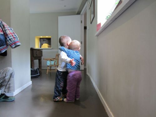 Two toddlers share a hug